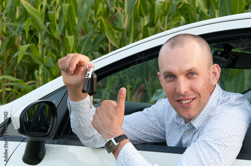 smiling man sitting in the car