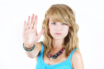 Young blond girl making STOP gesture