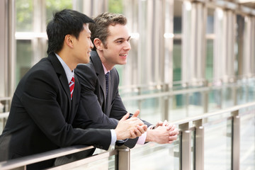 Two Businessmen Outside Modern Office