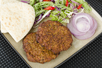 Shami Kebab - Spicy lamb patties, salad, pitta & red onions