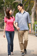 Young Chinese Couple Walking In Park