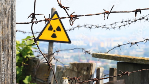 Radioactivity Sign and barbed wire.