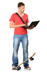 Young man with skateboard and notebook on white