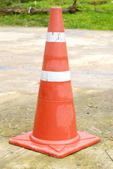 traffic cone - a orange road cone
