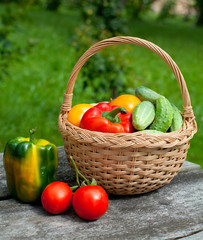vegetables in a basket on wooden table