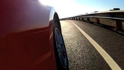 Luxury Car Driving Towards Golden Gate Bridge