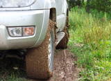 Extreme offroad behind an unrecognizable car in mud poster