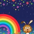 Cute rabbit in the night sky with rainbow