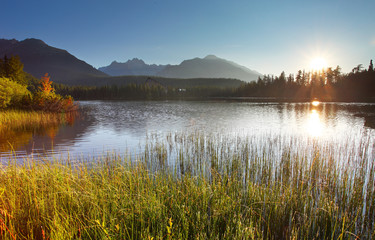 Sunset on mountain lake - Strbske pleso in Slovakia.