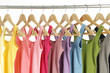 Row of different colorful shirt on hangers