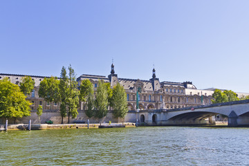 View of famous museum Louvre from the Seine River. Paris, France