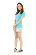 Happy young asian woman standing full length