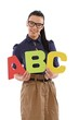 Pretty schoolmistress holding letters abc