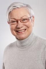 Closeup portrait of smiling elderly lady
