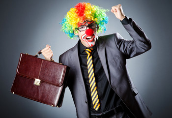 Businessman with clown wig and face paint