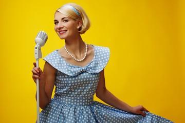 Woman singer in blue dress