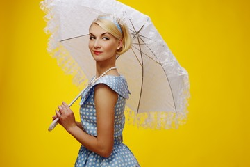 Woman in blue dress with a parasol