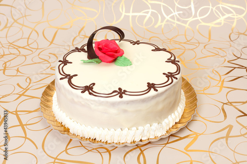 White cake with chocolate ornaments