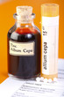 Allium Cepa plant extract, homeopathic pills on sheet