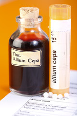 Allium Cepa plant extract, homeopathic pills on sheet