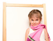 Little girl in scarf stands at the whiteboard