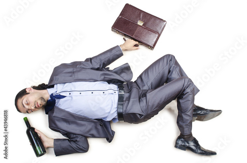 Drunk businessman on the floor