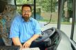Leinwanddruck Bild - Laughing Bus Driver