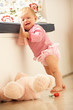 Upset Baby Girl Learning To Stand Up At Home