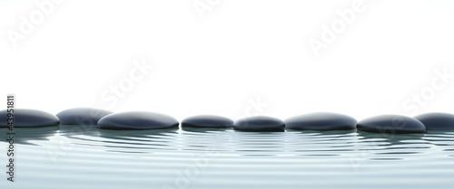 Leinwanddruck Bild Zen stones in water on widescreen