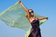 Beautiful woman holding up a green scarf