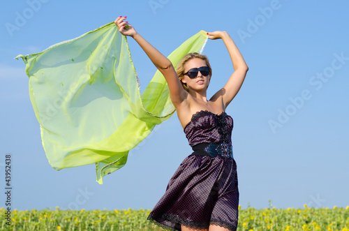 Woman with green scarf blowing in wind