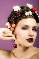 Beauty portrait woman with cherries in hair