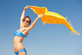 happy woman with yellow sarong on the beach - Fine Art prints