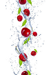 Fresh cherries falling in water splash