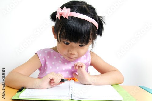 Kid is looking at book surprisingly