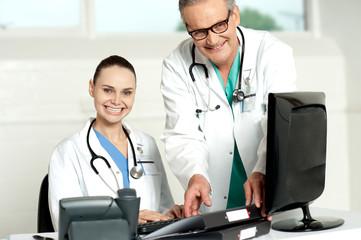 Team of doctors working on computer