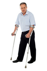 Old handicapped man with a walker