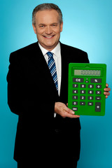 Senior manager showing big green calculator