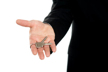 Businessman offering keys, closeup shot