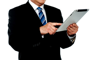 Businessman using tablet, cropped image