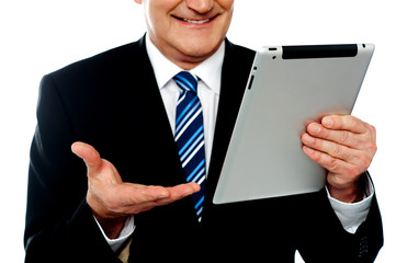 Cropped image of a businessman holding tablet pc