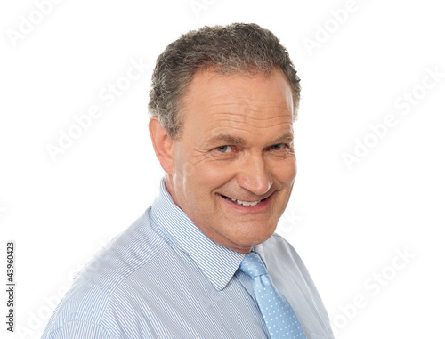 Closeup portrait of smiling senior male executive