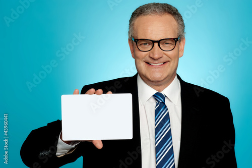 Businessman in glasses showing placard