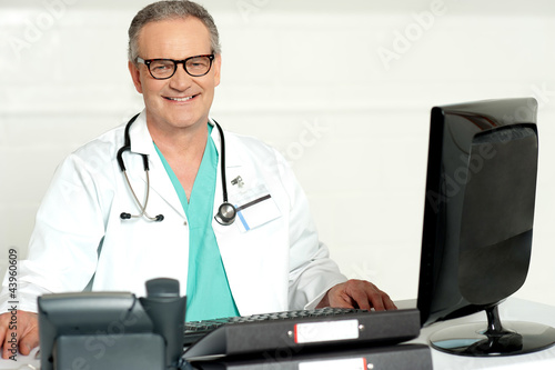 Aged physician with stethoscope around his neck