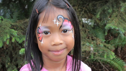 Cute Asian Girl Showing Off Her Face Paint Design