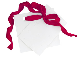 blank note with red ribbon