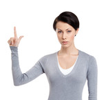 Young woman shows forefinger, attention sign, isolated on white
