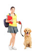 Full length portrait of a female student with dog