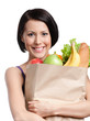 Attractive girl with the packet of fruit and vegetables
