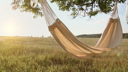 Hammock swinging on the wind at sunset